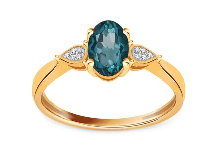 fde005d3b Zlatý dvojfarebný zásnubný prsteň s London Blue topásom a briliantami 0.020  ct ...